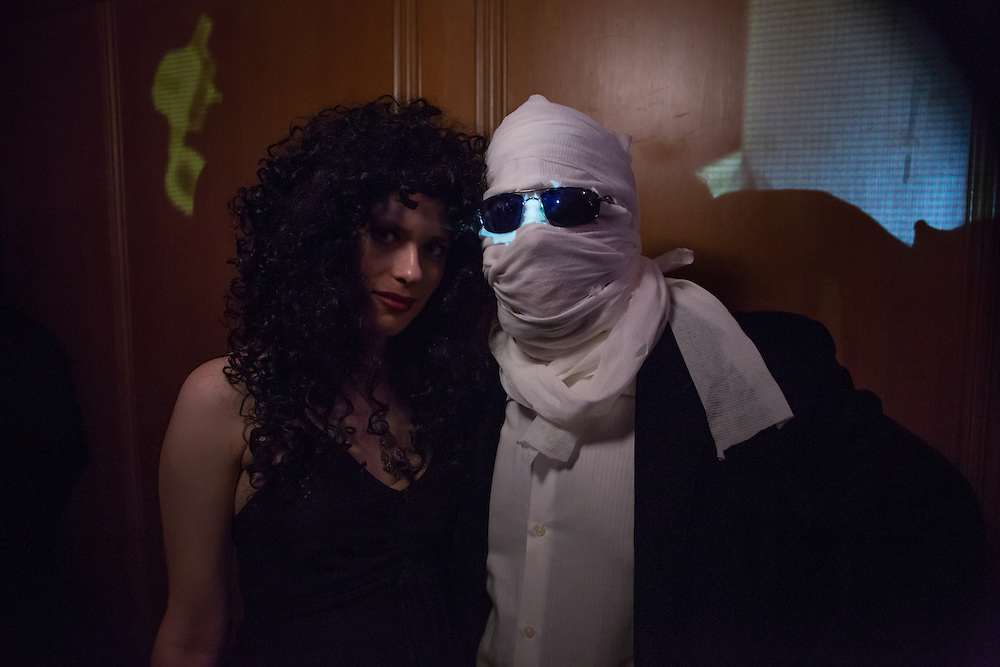 A man with a bandaged face and a woman.