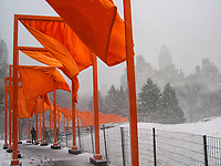 """""""The Gates,"""" by conceptual artists Christo and Jeanne-Claude's which consisted of an installation of 7,500 saffron-colored fabric panels hanging from 16-ft.-tall portals along 23 miles of walkway in Central Park."""