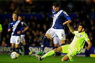 Kyle Lafferty of Birmingham City (L) in action with Connor Goldson of Brighton & Hove Albion ® tackling.<br /> Sky Bet Football League Championship match, Birmingham City v Brighton & Hove Albion at St.Andrew's Stadium in Birmingham, the Midlands on Tuesday 5th April 2016.<br /> Pic by Ian Smith, Andrew Orchard Sports Photography.