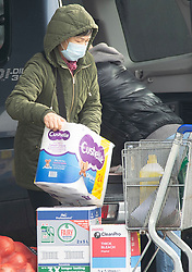 © Licensed to London News Pictures. 14/12/2020. <br /> Charlton, UK. A lady wearing a mask loading her car with loo roll. Its starting to look a lot like stockpiling in Charlton, South East London at the local Makro and Booker superstore, people have been coming out all morning with shopping trolleys full of loo roll and kitchen roll. Photo credit:Grant Falvey/LNP