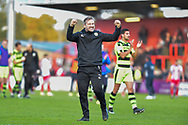 Forest Green Rovers assistant manager, Scott Lindsey celebrates with the fans at full time during the EFL Sky Bet League 2 match between Stevenage and Forest Green Rovers at the Lamex Stadium, Stevenage, England on 21 October 2017. Photo by Adam Rivers.