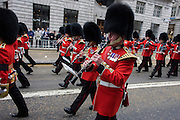 London 17/4/13 - Marching guardsmen before the funeral of Margaret Thatcher. Draped in the union flag and mounted on a gun carriage, the coffin of ex-British Prime Minister Baroness Margaret Thatcher's coffin travels along Fleet Street towards St Paul's Cathedral in London, England. Afforded a ceremonial funeral with military honours, not seen since the death of Winston Churchill in 1965, family and 2,000 VIP guests (incl Queen Elizabeth) await her cortege.