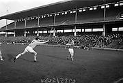 05/02/1967<br /> 02/05/1967<br /> 5 February 1967<br /> National Hurling League: Cork v Dublin at Croke Park, Dublin. <br /> Dublin full-back,   P. Corcoran (3) tries in vain to deflect a shot at a goal by Cork forward, C. McCarthy.