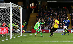Watford's Andre Gray scores his side's first goal of the game during the Premier League match at Vicarage Road, Watford.