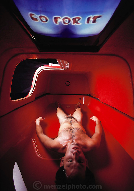 New Age meditation technology. Client lays inside a floatation tank at the John-David Learning Center in Carlsbad, California. MODEL RELEASED [1988]