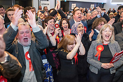 © Licensed to London News Pictures . 04/05/2018. Trafford, UK. Jubilant Labour Party supporters at the Trafford Council count at The Point at Lancashire County Cricket Club , as the results are declared . The Labour Party are looking to overturn the Conservative Party's majority on the council . Local council elections are taking place across the country . Photo credit : Joel Goodman/LNP