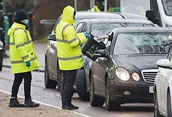 © Licensed to London News Pictures. 05/01/2021. London, UK. A member of the public places a self administer COVID-19 test in to a container at a temporary drive through COVID-19 test centre in Hyde Park, central London, as the UK is placed in to a third national lockdown. Photo credit: Ben Cawthra/LNP