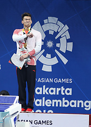 JAKARTA, Aug. 19, 2018  Xu Jiayu of China reacts during the awarding ceremony of Men's 100m Backstroke Final in the 18th Asian Games in Jakarta, Indonesia, Aug. 19, 2018. Xu won the gold medal. (Credit Image: © Fei Maohua/Xinhua via ZUMA Wire)