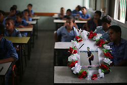 September 30, 2018 - Gaza City, The Gaza Strip, Palestine - CLass room friends grieve Naser Azmi Musabeh with a wreath of flowers on his disk, Naser an 11-year-old from Khan Younis southern of the Gaza strip Naser was hit with a live bullet in the head by Israeli troops during his demonstration in eastern Khan Younis last friday..Seven Palestinian protesters were killed and about 257 persons were injured by the Israeli military during the Great Return March demonstrations on Friday, 28 September 2018 in the Gaza Strip. Among those injured were 33 children, five women, four journalists, and one paramedic. 163 of the injured were shot with live fire, including 20 children and one woman. (Credit Image: © Hassan Jedi/Quds Net News via ZUMA Wire)