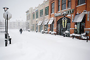 A man makes his way through the Woodland Park Crossing shopping center during what is being called an epic snowfall in Northern Virginia and D.C. Metro area.