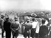 World War 2:German occupation of Paris, June 1940.  The German flag flying from the Arc de Triomphe