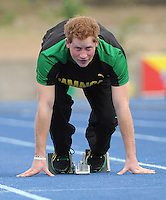 Prince Harry races Usain Bolt at the Usain Bolt track, University of the West Indies, Kingston, Jamaica, on the 6th March 2012.<br /> PICTURE BY JAMES WHATLING