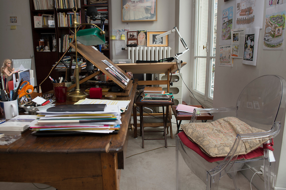 """March 11, 2015, Paris, France.  The now empty studio of Charlie Hebdo cartoonist Georges Wolinksi.  Since January 7th little has changed in the Paris' apartment where Georges Wolinski (1934 –2015) and  Maryse Wolinski (1943, Algiers) used to live. Two month after the death of Georges Wolinski, the apartment is full of souvenirs and notes, attesting a half-century-long love relation. In 2016 Maryse Wolinski published the book """"Chérie, je vais à Charlie"""" about her husband and the attack on Charlie Hebdo. The cartoonist Georges Wolinski was 80 years old when he was murdered by the French jihadists Chérif en Saïd Kouachi, he was one of the 12 victims of the massacre in the Charlie Hebdo offices on January 7, 2015 in Paris. Charlie Hebdo published caricatures of Mohammed, considered blasphemous by some Muslims. During his life, Georges Wolinski defended freedom, secularism and humour and was one of the major political cartoonists in France. The couple was married and had lived for 47 years together. Photo: Steven Wassenaar."""