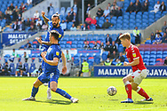Cardiff City midfielder Marlon Pack (21) shoots towards goal behind Kieffer More (10) *** during the EFL Sky Bet Championship match between Cardiff City and Bristol City at the Cardiff City Stadium, Cardiff, Wales on 28 August 2021.