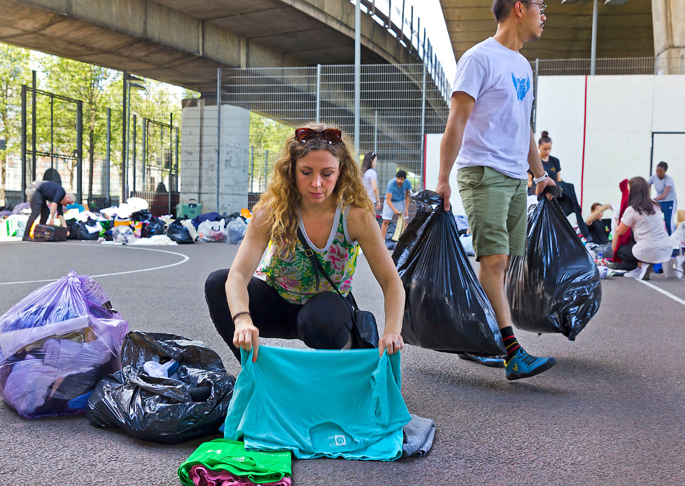 14 June 2017 taken between the hours of 16.27 - 18.50.<br /> <br /> Westway sports and fitness centre became one of the focal points for clothing donations. Volunteers sort through the donations<br /> <br /> The Grenfell Tower fire occurred on 14 June 2017 at the 24-storey, 220-foot-high (67 m), tower block of public housing flats in North Kensington, Royal Borough of Kensington and Chelsea, West London. It caused at least 80 deaths and over 70 injuries. A definitive death toll is not expected until at least 2018. As of 5 July 2017, 21 victims had been formally identified by the Metropolitan Police. Authorities were unable to trace any surviving occupants of 23 of the flats. ( Source Wikipedia}