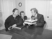 Garret Fitzgerald Birthday.1982.09.02.1982..02.09.1982..9th February 1982.Garret Fitzgerald celebrates his 56th birthday..Photograph of Garret ,his wife Joan and son, Mark as they take time to clebrate his birthday at their Palmerstown home  .It takes a lot of puff to blow out the candles.  .
