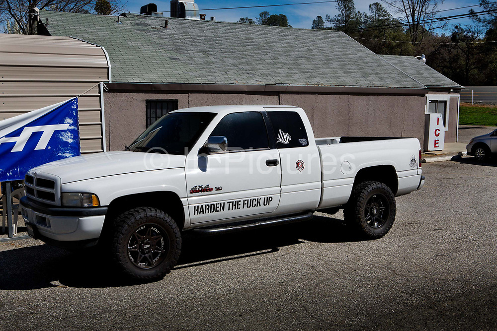 Bumper sticker style Message on side of truck saying 'Harden the fuck up' in central valley, California