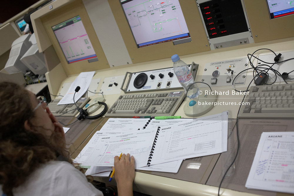 A European Space Agency technician at Ariane launch control monitors the rocket systems hours before satellite launch