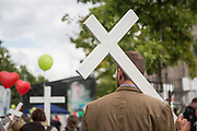 "A participants in ""The March For Life"" is seen carrying a wooden cross prior to the beginning of the event, in Berlin's Mitte district, on September 16, 2017. In the center of the pro-life event was the call by the organizers for German politicians and society to take active action against a ""silent increase of acceptance"" of the phenomenon. Abortion in Germany is permitted in the first trimester of the pregnancy, with the condition of mandatory counseling and in a later period of the pregnancy in cases of medical necessity.<br /> (Photo by Omer Messinger)"