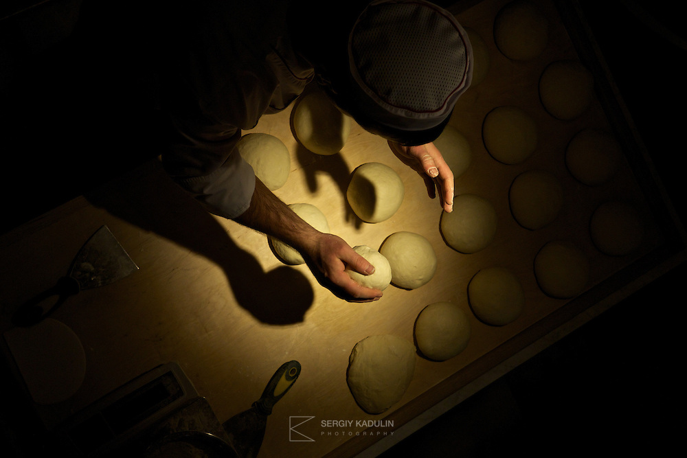Handmade Shoti bread at the table. Top down view, process of preparing Shoti bread for the oven.