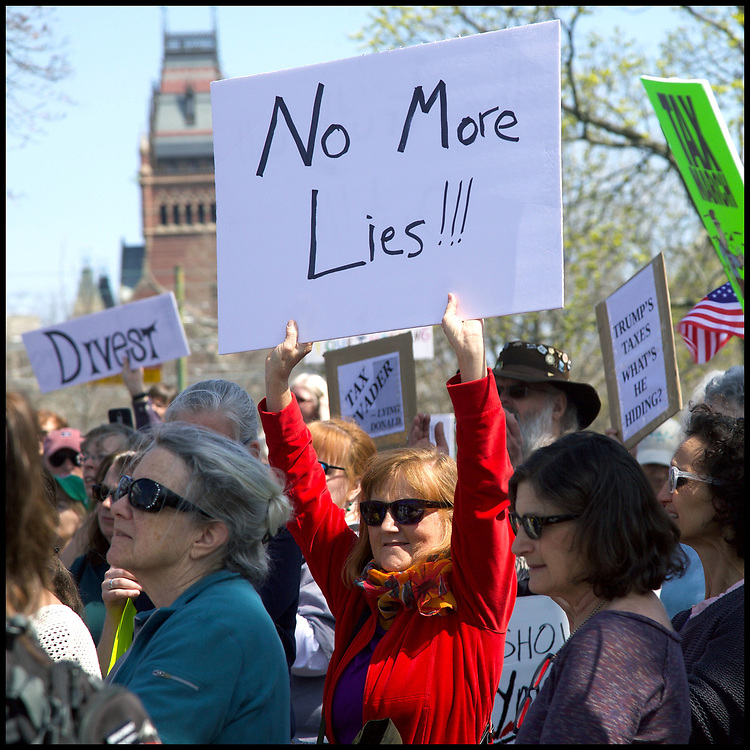 """A crowd of approximately 2,000 called for President Donald Trump to release his tax returns and change his policies during a rally on Cambridge Common on April 15, 2017. It was part of a """"Tax March"""" series of protests held in some 200 cities nationwide."""