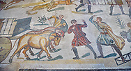 Ambulatory of the Great Hunt Roman mosaic, Wagons being pulled by bullocks, room no 28, at the Villa Romana del Casale, first quarter of the 4th century AD. Sicily, Italy. A UNESCO World Heritage Site.<br /> <br /> The Great Hunt ambulatory is around 60 meters long (200 Roman feet) and connects the master's northern apartments with the triclinium in the south. The door in the centre of the the Great Hunt ambulatory leads to audience hall. <br /> <br /> The Great Hunt Roman mosaic depicts African animals being hunted and put onto ships to be taken to the Colosseum. .<br /> <br /> If you prefer to buy from our ALAMY PHOTO LIBRARY  Collection visit : https://www.alamy.com/portfolio/paul-williams-funkystock/villaromanadelcasale.html<br /> Visit our ROMAN MOSAIC PHOTO COLLECTIONS for more photos to buy as buy as wall art prints https://funkystock.photoshelter.com/gallery/Roman-Mosaics-Roman-Mosaic-Pictures-Photos-and-Images-Fotos/G00008dLtP71H_yc/C0000q_tZnliJD08