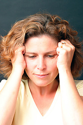 Portrait of woman aged 40 looking depressed or fed up