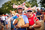 A couple and dog dressed in patriotic costume in the I'On Community 4th of July parade.