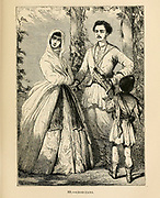 A Georgian family in traditional clothes. Engraving on wood From The human race by Figuier, Louis, (1819-1894) Publication in 1872 Publisher: New York, Appleton