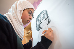 18 February 2020, Amman, Jordan: Fifteen-year-old Asma works on a painting in the Talent Room of Rufaida Al Aslamieh Primary Mixed School in the Sahab district. The school serves more than 1,000 students from kindergarten up to 10th grade, most of them girls from Jordan but also some from Syria and other countries, and, in the lower grades, also boys. With support from the Lutheran World Federation, the school has refurbished its rooms and buildings and introduced a 'Talent Room' in order to nurture the children's creativity. This type of learning environment is otherwise rare in Jordanian public shools.