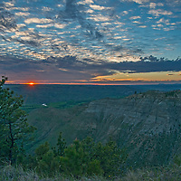 Eroded coulees drain into the Judith River Valley in the Upper Missouri River Breaks of central Montana.