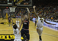 December 29 2010: Illinois Fighting Illini center Mike Tisdale (54) puts up a shot over Iowa Hawkeyes forward Zach McCabe (15) as Iowa Hawkeyes guard/forward Roy Devyn Marble (4) closes in during the first half of an NCAA college basketball game at Carver-Hawkeye Arena in Iowa City, Iowa on December 29, 2010. Illinois defeated Iowa 87-77.