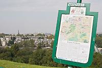 Sign bearing information on the Krakus Mound sits at an angle following vandalism