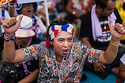 16 MAY 2014 - BANGKOK, THAILAND: A woman cheers for anti-government leader Suthep Thaugsuban in front of the parliament complex in Bangkok. Thousands of protestors from the People's Democratic Reform Committee (PDRC) surrounded the Thai Parliament complex Saturday to pressure the Thai Senate to select an interim Prime Minister to replace ousted former PM Yingluck Shinawatra. The Senate decided not to appoint an interim PM of their own and announced a meeting with the current interim Prime Minister. The protestors left the parliament complex and threatened to return in larger numbers if the Senate doesn't act. The Senate appointment of an acting PM could plunge Thailand into chaos since there is already an interim Prime Minister from the ruling Pheu Thai party.     PHOTO BY JACK KURTZ