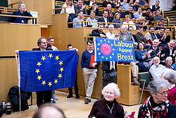 © Licensed to London News Pictures. 13/01/2018. London, UK. An anti-brexit flag being waved as a counter demonstration to a group of protesters shouting pro-Brexit and Pro-Donald Trump slogans at Mayor of London Sadiq Khan while he speaks at the Fabian Society New Year conference in London. Police were called to deal with the incident at the annual gathering of the British socialist movement.  Photo credit: Tom Nicholson/LNP