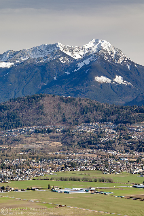Mount McGuire provides a mountain backdrop to the housing and farmland in the Promontory area of Chilliwack, British Columbia, Canada. Photographed from Hillkeep Regional Park on Chillwack Mountain.