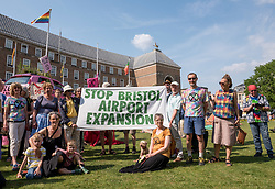 © Licensed to London News Pictures. 16/07/2019; Bristol, UK. Extinction Rebellion Summer Uprising 2019. Stop Bristol Airport Expansion at the Youth XR gathering on College Green where Billy Bragg performed songs. Extinction Rebellion are holding a five-day 'occupation' of Bristol, by occupying Bristol Bridge in the city centre and traffic has to be diverted and carrying out other events. As part of a country-wide rebellion called Summer Uprising, followers will be holding protests in five cities across the UK including Bristol on the theme of water and rising sea levels, which is the group's focus for the South West. The campaign wants the Government to change its recently-set target for zero carbon emissions from 2050 to 2025.<br /> In Bristol Extinction Rebellion plan a week-long occupation of Bristol Bridge in the city centre from Monday and organisers anticipate more than 1,000 people will take part in the action. On Tuesday, they will occupy College Green in front of the city's council house before protesting outside the Ministry of Defence in Stoke Gifford on Friday Photo credit: Simon Chapman/LNP.