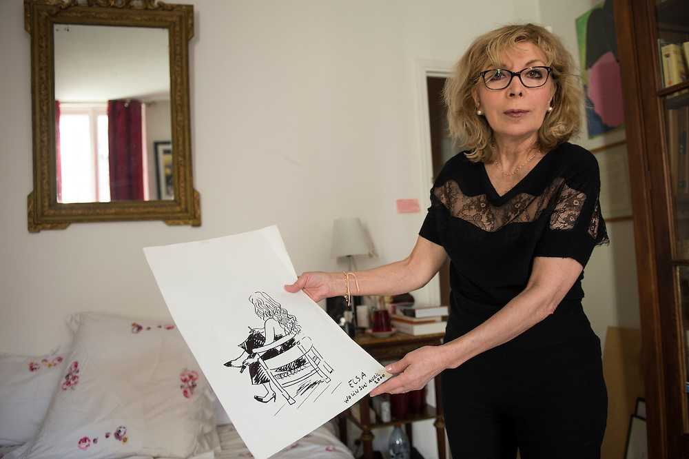 March 6, 2015, Paris, France. Writer Maryse Wolinski (1943, Algiers), in the bedroom of her Paris apartment, shows a drawing made by her husband Georges Wolinski (1934-2015), a French artist who often portrayed her. After the Islamist terrorist attack on Charlie Hebdo and his death,  two month earlier Maryse Wolinski deals with loss. The cartoonist Georges Wolinski was 80 years old when he was murdered by 2 jihadists, he was one of the 12 victims of the massacre in the Charlie Hebdo offices on January 7, 2015 in Paris, after publishing caricatures of Mohammed, considered blasphemous by some Muslims. Georges Wolinski defended freedom, secularism and humour and was one of the major political cartoonists in France. The couple was married and lived since 47 years together. Photo: Steven Wassenaar.