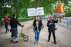 "© Licensed to London News Pictures. 03/06/2019. London, UK. Two protesters on The Mall carrying a placard which reads 'IMPEACHMENT IS COMING' and a helium ""Baby Trump"" balloon. President Trump is in the UK for a three-day State Visit. Photo credit: Rob Pinney/LNP"