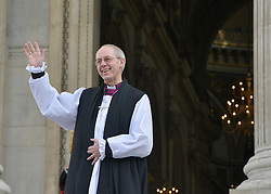 © Licensed to London News Pictures. 04/02/2013. City of London, UK Justin Welby, stands on the steps of St Pauls Cathedral in London for the first time as the Archbishop of Canterbury, He takes the title today, 4th February 2013, following formal election by the College of Canons on January 10, Bishop of Durham Justin Welby becomes Archbishop of Canterbury, a title conferred upon him by the Archbishop of York on behalf of his fellow bishops and the wider Church.. Photo credit : Stephen Simpson/LNP