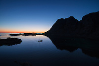 Sailboat anchorage in summer twilight at Buvågen bay at Helle on the westernmost tip of Moskenesøy, Lofoten Islands, Norway
