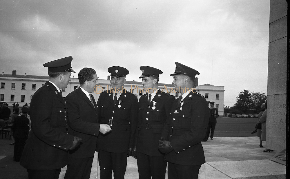 Scott Medals for bravery were presented to four Gardai by Brian Lenihan T.D., Minister for Justice, before he unveiled  the Garda Memorial at the Garda Headquarters. Mr. Lenihan chats with the recipients of the Scott Medals: William A. Barrett, Rathmines; Patrick Farrell, Clonmel; Patrick J. McIntyre, Rathmore; and Timothy Mahony, Pearse Street..21.10.1966