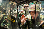 25 MAY 2014 - BANGKOK, THAILAND:  A Thai soldier screams at anti-military protestors during a rally against the coup in Bangkok. Public opposition to the military coup in Thailand grew Sunday with thousands of protestors gathering at locations throughout Bangkok to call for a return of civilian rule and end to the military junta.    PHOTO BY JACK KURTZ