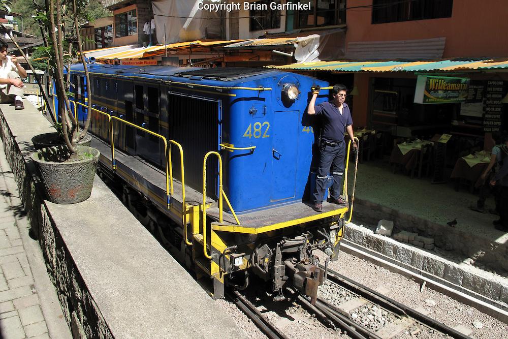 A Perurail Locomotive moves through Aguas Calientes