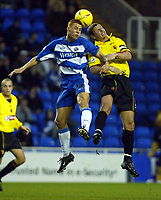 Photograph: Scott Heavey.<br />Reading v Watford. Nationwide Division One. 29/11/2003.<br />Steve Sidwell (L) outjumps the Watford skipper, Neil Cox