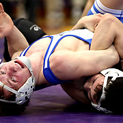 Perrysburg's Blake Saito, bottom, tries to keep Anthony Wayne's Zack Snyder down as the two wrestle at 132 pounds during the championship round at the Northern Lakes League high school wrestling tournament hosted at Maumee High School in Maumee, Ohio, on Saturday, February 16, 2019. THE BLADE/KURT STEISS