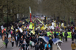 © Licensed to London News Pictures. 03/04/2021. London, UK. Protesters march along Birdcage Walk to Parliament Square in central London during a 'Kill the Bill' demonstration and rally. A coalition of groups including Extinction Rebellion, Kill the Bill & Black Lives Matter are coming together over the Easter weekend to campaign against the proposed Police, Crime, Sentencing and Courts Bill which will give police in England and Wales more power to impose conditions on non-violent protests. Photo credit: Peter Macdiarmid/LNP