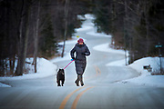 Judy Roemer of Green Bay takes her dog Chica on a winter walk along the winding from from Gills Rock to Northport at the tip of the Door County Peninsula in northeast  Wisconsin.