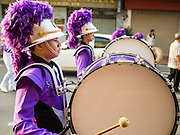 30 OCTOBER 2014 - BANGKOK, THAILAND: A high school marching band performs on Bamrung Muang Street during the parade marking the start of the annual temple fair at Wat Saket. Wat Saket is on a man-made hill in the historic section of Bangkok. The temple has golden spire that is 260 feet high which was the highest point in Bangkok for more than 100 years. The temple construction began in the 1800s in the reign of King Rama III and was completed in the reign of King Rama IV. The annual temple fair is held on the 12th lunar month, for nine days around the November full moon. During the fair a red cloth (reminiscent of a monk's robe) is placed around the Golden Mount while the temple grounds hosts Thai traditional theatre, food stalls and traditional shows.   PHOTO BY JACK KURTZ