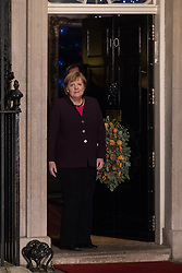 London, UK. 3 December, 2019. Angela Merkel, Chancellor of Germany, arrives for a reception for NATO leaders at 10 Downing Street on the eve of the military alliance's 70th anniversary summit at a luxury hotel near Watford.
